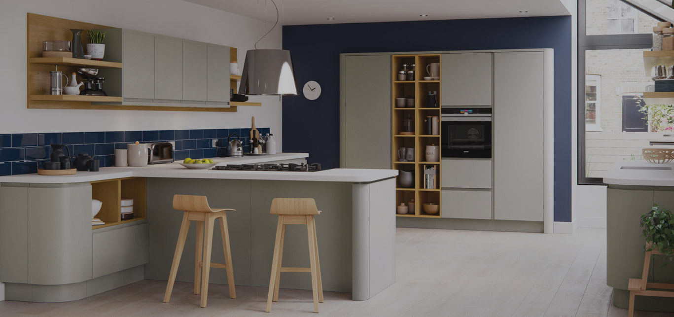 Modern minimal kitchen in Long Eaton, Nottingham. Strong, angular style mixed with long unbroken lines, smooth surfaces alongside bold accents. White stone kitchen worktop, timber bar stools, curved kitchen cabinets.