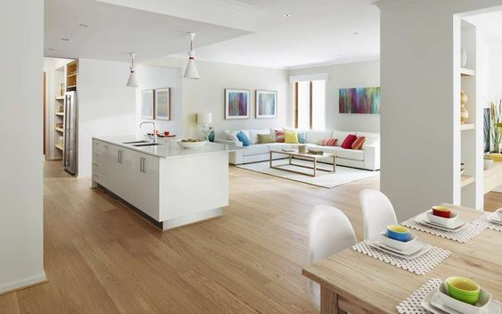 House renovation, open plan living, white kitchen cabinets, white kitchen worktop, timber floor, light bright colours.